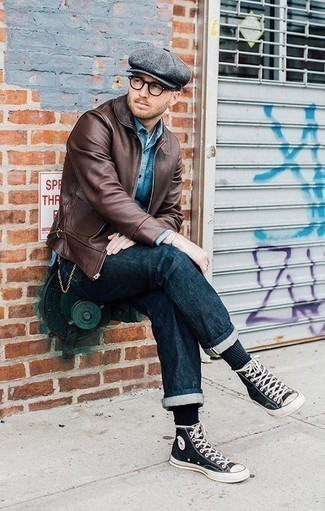 How to Wear a Flat Cap For Men: A brown leather bomber jacket and a flat cap are wonderful menswear must-haves that will integrate well within your off-duty styling rotation. Give an added dose of elegance to this ensemble by wearing a pair of black and white canvas high top sneakers.