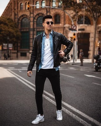 White Low Top Sneakers with Black Jeans Warm Weather Outfits For Men In Their 20s: This pairing of a black leather bomber jacket and black jeans is clean, dapper and extremely easy to copy. Complete this ensemble with a pair of white low top sneakers and ta-da: this outfit is complete. Gentlemen who are curious how to wear edgy casual style as you cruise through your 20s, this getup should answer your question.