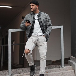 White and Black Print Crew-neck T-shirt Outfits For Men: For a relaxed outfit, wear a white and black print crew-neck t-shirt and grey ripped skinny jeans — these pieces go nicely together. Introduce charcoal athletic shoes to the equation and you're all done and looking boss.