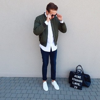 How to wear: dark green bomber jacket, white long sleeve shirt, navy jeans, white low top sneakers