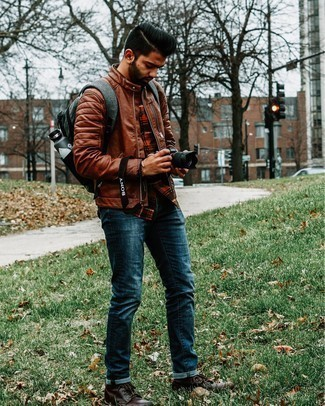 Charcoal Canvas Backpack Outfits For Men: When the setting allows casual street styling, try pairing a brown leather bomber jacket with a charcoal canvas backpack. On the shoe front, go for something on the classier end of the spectrum with a pair of dark brown leather casual boots.