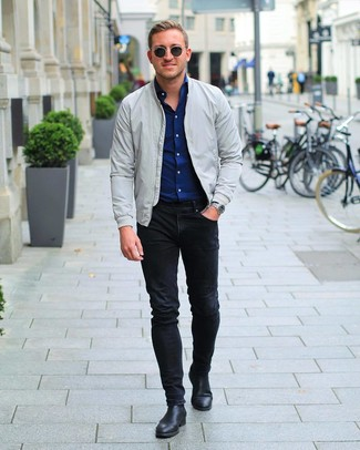 How to Wear a Navy Long Sleeve Shirt In Your 20s For Men: Make a navy long sleeve shirt and black skinny jeans your outfit choice for a cool and casual and trendy ensemble. Balance this ensemble with a smarter kind of shoes, such as these black leather chelsea boots.