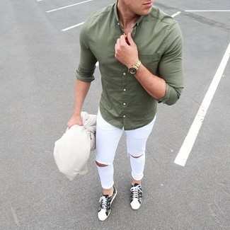 How to Wear a White Bomber Jacket For Men: Opt for a white bomber jacket and white ripped skinny jeans if you're on the lookout for an outfit option that speaks casual street style style. Olive camouflage low top sneakers are guaranteed to inject a dash of polish into your getup.