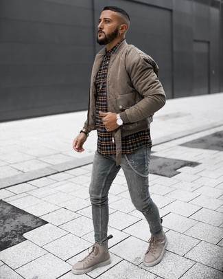 Beige Leather Casual Boots Outfits For Men: A brown bomber jacket and grey ripped skinny jeans are the kind of casual staples that you can style a great deal of ways. Rounding off with a pair of beige leather casual boots is an effective way to add a bit of flair to this outfit.