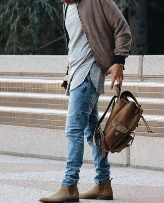 How to wear: brown bomber jacket, grey long sleeve t-shirt, blue jeans, brown suede chelsea boots