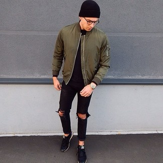 How to wear: olive bomber jacket, black long sleeve t-shirt, black ripped jeans, black low top sneakers