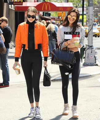 How to wear: orange bomber jacket, black mesh long sleeve t-shirt, black leggings, black and white canvas high top sneakers