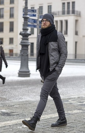 How to wear: grey quilted bomber jacket, black long sleeve t-shirt, charcoal skinny jeans, black leather casual boots