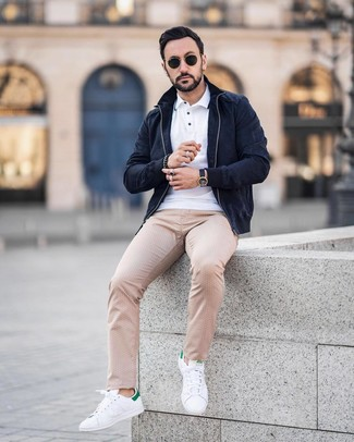 How to wear: navy suede bomber jacket, white polo, beige polka dot chinos, white and green leather low top sneakers