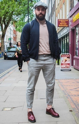 How to Wear a Pink Polo For Men: This combination of a pink polo and grey chinos is a safe bet for a devastatingly dapper outfit. For something more on the elegant end to round off your ensemble, add burgundy leather brogues to the mix.