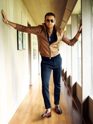 Dress in a brown leather bomber jacket and deep blue dress pants for a sharp, fashionable look. Mix things up by wearing brown leather loafers.