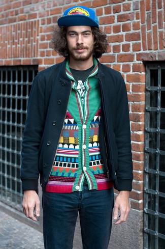 How to wear: dark green bomber jacket, green geometric shawl cardigan, dark green print crew-neck t-shirt, teal jeans