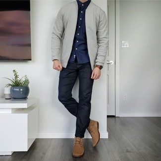 Tan Suede Desert Boots Outfits: Combining a grey bomber jacket with black jeans is an on-point idea for a relaxed look. Let your styling credentials truly shine by rounding off this look with a pair of tan suede desert boots.