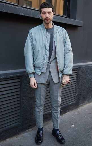 How to Wear a Charcoal Crew-neck T-shirt For Men: Extremely dapper and functional, this laid-back combo of a charcoal crew-neck t-shirt and a light blue bomber jacket provides variety. For something more on the classier end to complete this look, complement your look with black leather tassel loafers.