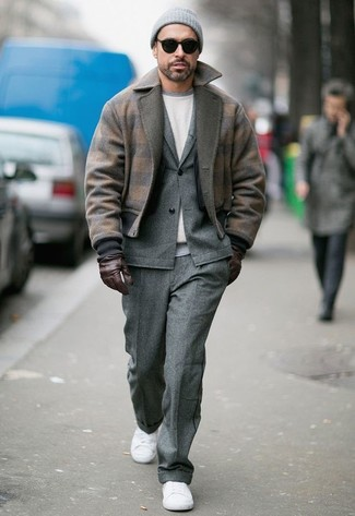How to wear: brown wool bomber jacket, grey wool suit, white sweatshirt, white canvas low top sneakers