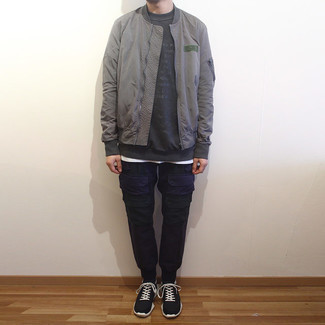 Grey Bomber Jacket Outfits For Men In Their 30s: A grey bomber jacket and navy cargo pants paired together are a perfect match. Put a different spin on your outfit by finishing with a pair of black and white athletic shoes. Perfect if you're looking for some amazingly inspiring Millennial relaxed casual style.