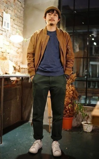 How to Wear Beige Leather Low Top Sneakers For Men: Go for a simple but casually dapper look pairing a tobacco bomber jacket and dark green chinos. Send this look in a more casual direction by sporting a pair of beige leather low top sneakers.