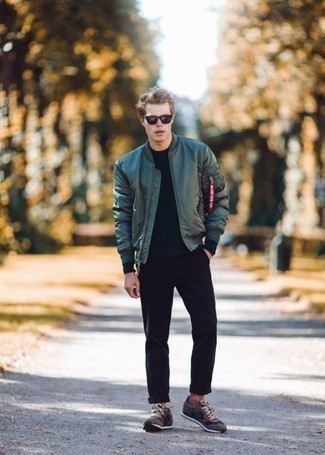 How to Wear a Dark Green Bomber Jacket For Men: A dark green bomber jacket and black chinos are the kind of a no-brainer casual outfit that you need when you have no time. Brown athletic shoes will give a carefree touch to an otherwise sober look.