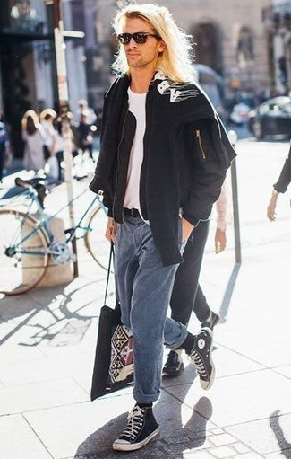 How to Wear Blue Jeans For Men: For something on the cool and casual end, you can easily rock a black bomber jacket and blue jeans. Demonstrate your mellow side by finishing with black and white canvas high top sneakers.