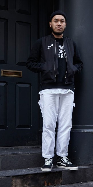Black Bomber Jacket Outfits For Men: Demonstrate your skills in men's fashion by opting for this casual pairing of a black bomber jacket and white cargo pants. Serve a little mix-and-match magic by wearing navy and white canvas high top sneakers.