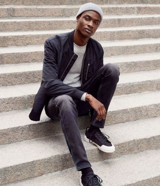 How to Wear Charcoal Jeans For Men: A black bomber jacket and charcoal jeans? It's easily a wearable ensemble that any guy can work on a daily basis. Add a pair of black and white canvas low top sneakers to your ensemble and the whole ensemble will come together perfectly.