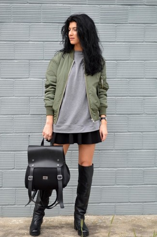 Black Leather Knee High Boots Casual Outfits: An olive bomber jacket and a black skater skirt are a smart combo to keep in your daily rotation. For a sleeker twist, why not grab a pair of black leather knee high boots?
