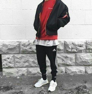 Black Bomber Jacket Outfits For Men: If you're in search of a laid-back yet dapper getup, consider wearing a black bomber jacket and black sweatpants. Does this outfit feel all-too-fancy? Let a pair of white athletic shoes shake things up.