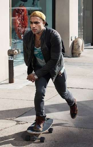 How to Wear a White Print Tank For Men: This laid-back pairing of a white print tank and charcoal jeans is effortless, seriously stylish and super easy to imitate. For maximum style points, introduce brown leather high top sneakers to this ensemble.