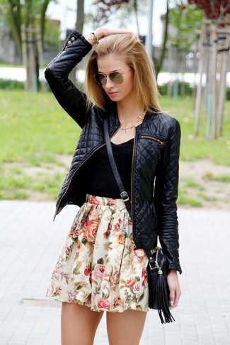 Make a black tank and a nude floral skater skirt your outfit choice for a lazy day look.