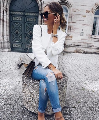 White Bomber Jacket Outfits For Women: A white bomber jacket and blue ripped skinny jeans are a great combo worth integrating into your daily collection. Add beige suede heeled sandals to your outfit to make the outfit a bit more polished.