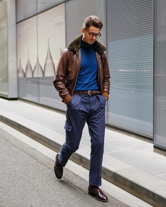 How to wear: brown leather bomber jacket, blue turtleneck, navy cargo pants, burgundy leather loafers