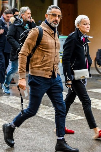 If you're scouting for a casual yet sharp getup, pair a tan leather bomber jacket with navy chinos. Both items are totally comfortable and will look great together. Wearing a pair of black leather casual boots is an easy way to add some flair to your look.