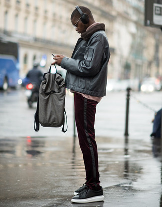 How to wear: black leather bomber jacket, pink knit turtleneck, burgundy corduroy chinos, black leather low top sneakers