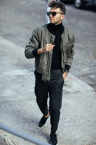 How to Wear a Black Turtleneck For Men: This combo of a black turtleneck and charcoal chinos is simple, stylish and extremely easy to imitate. Bump up the cool of your look with a pair of black low top sneakers.