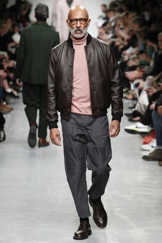 How to Wear a Pink Turtleneck For Men: This look with a pink turtleneck and charcoal vertical striped chinos isn't a hard one to pull off and is easy to adapt. A pair of burgundy leather derby shoes will give a strong and masculine feel to any getup.