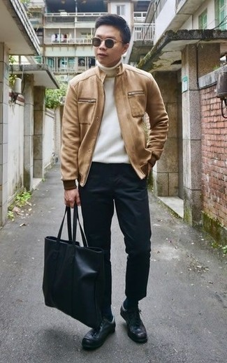 Tan Leather Jacket Outfits For Men: This casual combination of a tan leather jacket and black chinos can go different ways according to how it's styled. Bring an easy-going vibe to your look by slipping into a pair of black leather low top sneakers.