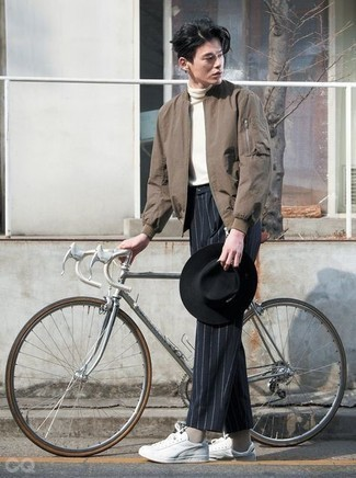 Tan Socks Outfits For Men: For a city casual getup without the need to sacrifice on practicality, we turn to this combination of a brown bomber jacket and tan socks. Tone down the casualness of your outfit with a pair of white canvas low top sneakers.