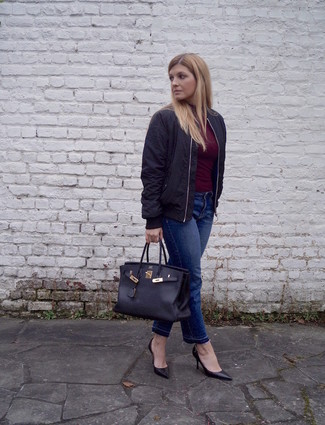 A dark red turtleneck with dark blue jeans has become an essential combination for many style-conscious girls. Black leather pumps will add a touch of polish to an otherwise low-key look.