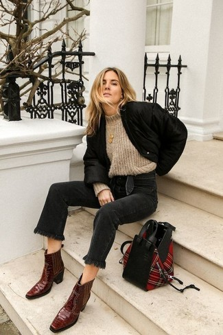 How to wear: black bomber jacket, beige knit wool turtleneck, black jeans, burgundy leather cowboy boots