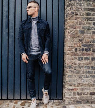 How to wear: navy suede bomber jacket, grey turtleneck, navy jeans, beige leather desert boots