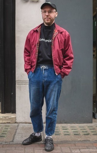 How to Wear Black Leather Low Top Sneakers For Men: You'll be surprised at how extremely easy it is for any man to get dressed like this. Just a burgundy bomber jacket and blue jeans. Introduce a pair of black leather low top sneakers to the mix et voila, the look is complete.