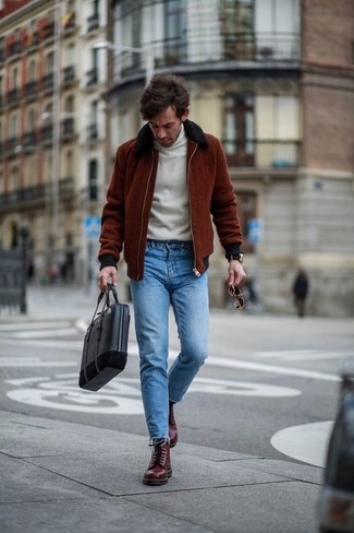 How to wear: burgundy bomber jacket, white turtleneck, blue skinny jeans, burgundy leather casual boots