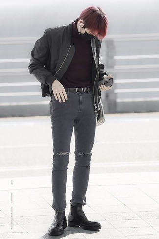 How to Wear Black Leather Chelsea Boots For Men: Choose a black bomber jacket and charcoal ripped skinny jeans for a stylish and urban outfit. You can get a bit experimental on the shoe front and spruce up your look by wearing black leather chelsea boots.