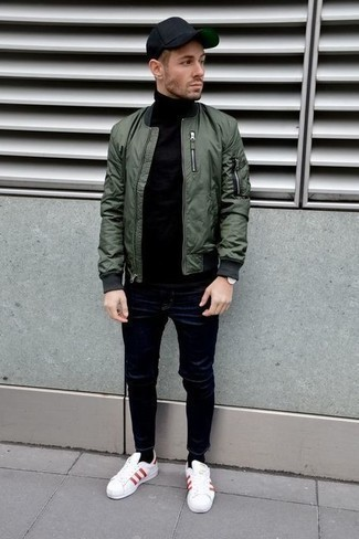 Bomber Jacket with Skinny Jeans Outfits For Men: This relaxed combo of a bomber jacket and skinny jeans is a real life saver when you need to look sharp in a flash. A pair of white and red canvas low top sneakers is a smart choice to finish this ensemble.