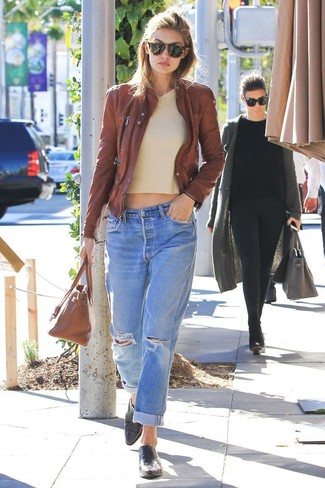 How to wear: brown leather bomber jacket, beige v-neck sweater, light blue ripped boyfriend jeans, black leather loafers