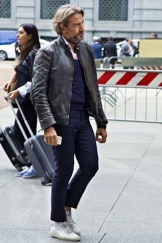 How to Wear a Black Leather Bomber Jacket For Men: A black leather bomber jacket looks so casually stylish when combined with navy chinos. For a truly modern on and off-duty mix, introduce white leather low top sneakers to the equation.