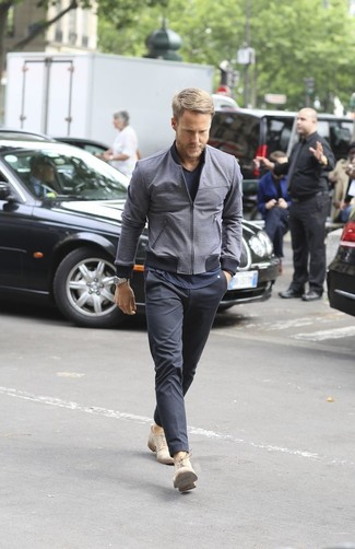 How to wear: charcoal bomber jacket, navy v-neck t-shirt, charcoal chinos, beige suede derby shoes