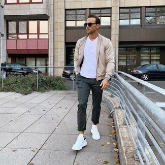 Silver Watch Outfits For Men: Consider pairing a beige bomber jacket with a silver watch, if you enjoy relaxed dressing without looking like a slob to look dapper. On the fence about how to complete this outfit? Rock white and black canvas low top sneakers to kick it up.