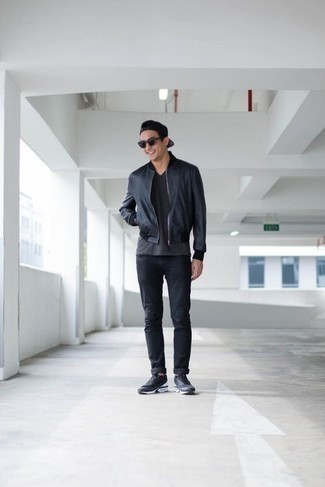 How to Wear a V-neck T-shirt For Men: Reach for a v-neck t-shirt and black jeans for a laid-back kind of sophistication. Charcoal athletic shoes are an effortless way to inject a sense of stylish effortlessness into your ensemble.