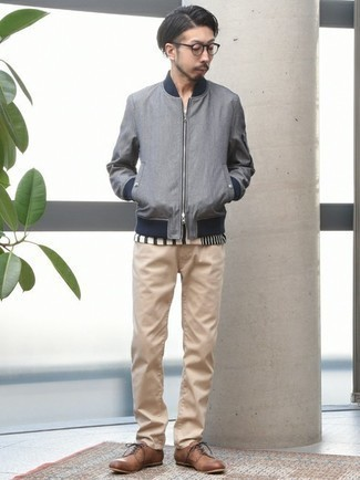 Grey Bomber Jacket Outfits For Men In Their 30s: If the situation permits off-duty dressing, you can dress in a grey bomber jacket and khaki jeans. Up the dressiness of your ensemble a bit by rounding off with a pair of brown leather derby shoes. Perfect to create a more mature look.
